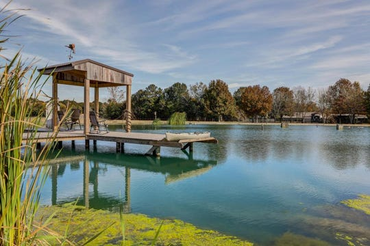 A huge pond with a new deck sits on the property of the nearly 8,000-square-foot Youngsville mansion.