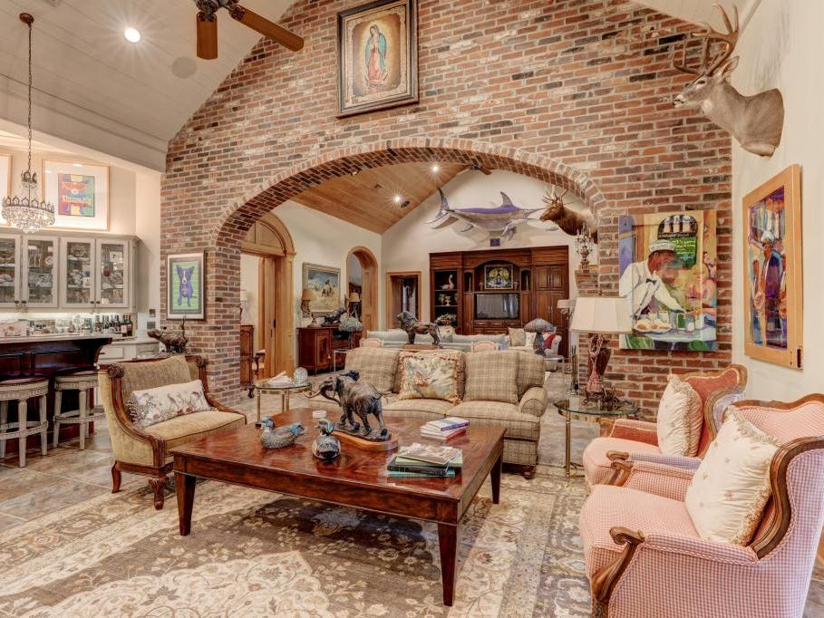 The main house of the nearly 8,000-square-foot Youngsville mansion has two living rooms, an upstairs den and a game room.