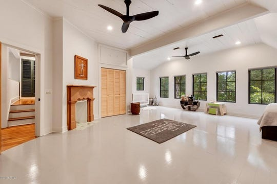 The huge master bedroom has lots of natural light and a fireplace for a sleek look