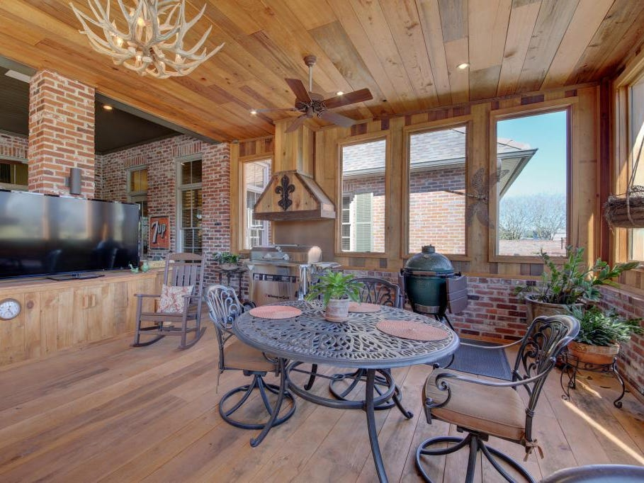 The screened porch of the nearly 8,000-square-foot Youngsville mansion is one of many perks.