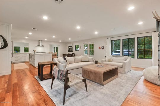 The open floor plan starts in the living room and flows throughout the house