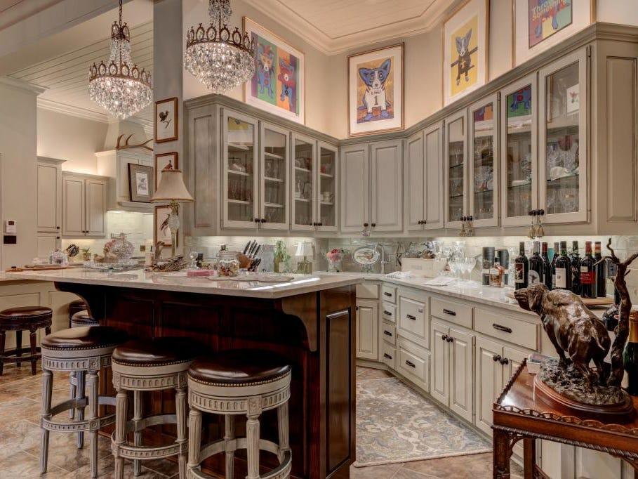 The kitchen in the nearly 8,000-square-foot Youngsville mansion boasts updated countertops and appliances.