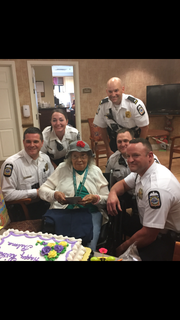Columbus Police Department officers help Carroll Place resident Thelma Ayler celebrate her 97th birthday Monday. Pictured (l-r) are Officers Adam Hardwick, Amber Rich, Ayler, Rob Sagle, Marc Rees and Mel Romans. Hardwell and Romans met Ayler last year on her 96th birthday when they helped her secure her door at her Columbus residence. She since moved to Carroll Place.