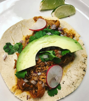 An authentic Mexican chicken taco made by food truck owner Regina Guerra features a corn tortilla, avocado and lime. Regina's Food Truck is participating in food truck events in Howell this spring.