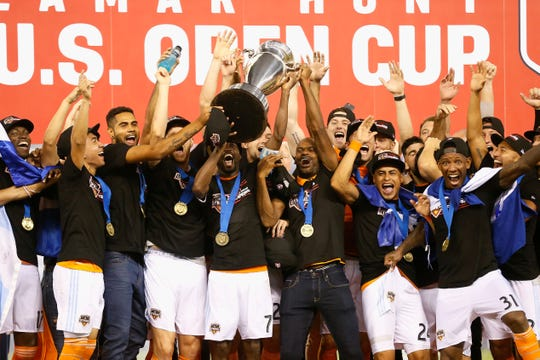 DaMarcus Beasley #7 of Houston Dynamo lifts up the championship trophy after defeating the Philadelphia Union 3-0 during the 2018 Lamar Hunt U.S. Open Cup final at BBVA Compass Stadium on September 26, 2018 in Houston, Texas.