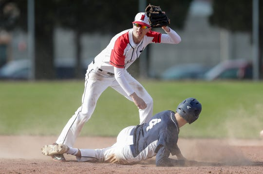 Manitowoc Lincoln's second baseman Josh Hoffman (5) makes the out against Bay Port's Call Verlanic (4) during a doubleheader at Municipal Field Monday, May 6, 2019, in Manitowoc, Wis.