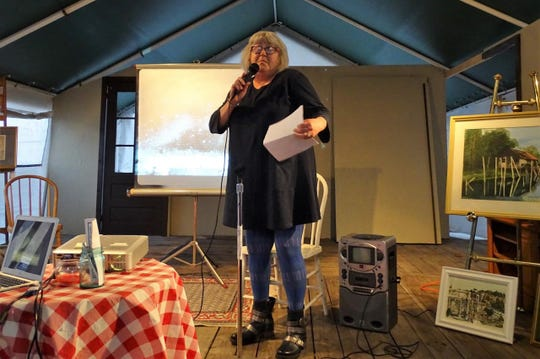 Jody Kuchar shares her poetry at the 2018 Art Slam Poetry Slam, hosted by Kathie's Stage Door Pub.