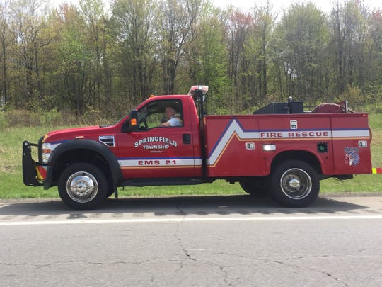A Springfield Township Fire Department vehicle drives along U.S. 30 in Ontario on Tuesday afternoon after firefighters put out several grass fires along the berm.