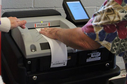 Patricia Douce officially cast her vote at the Veterans Memorial Coliseum during the election on Tuesday.