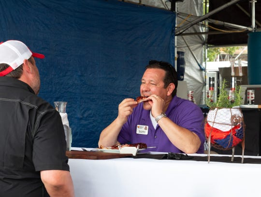 Ron Childers of of WMC Action News 5 is a longtime barbecue judge.  Here he is tasting a contestant's ribs during the on-site judging process.