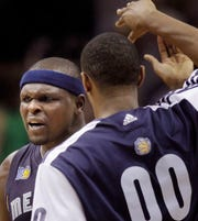 Former Memphis Grizzlies center Zach Randolph celebrates the franchise's first-ever playoff win after beating the Spurs on April 17, 2011, in San Antonio.