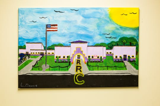 A painting of the Robert R. Church Elementary School is seen inside of the school's main office on May 1, 2019, in Memphis, Tenn.