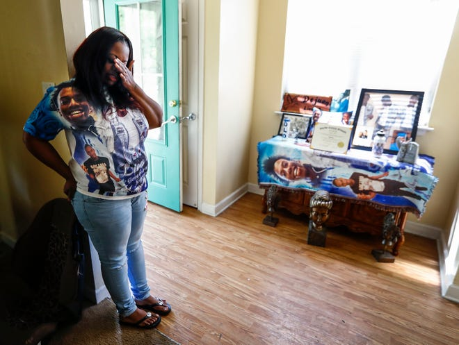 Talisha Brooks wipes away tears as she talks about a shrine she made for her son Dejuan Hill, who was shot and killed near Crosstown Concourse last year.