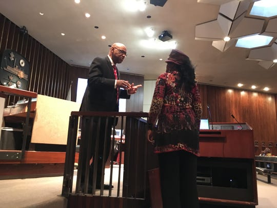 Memphis City Councilman Joe Brown speaks with activist Carnita Atwater at the May 7 city council meeting.