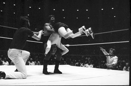 "Jerry ""The King"" Lawler takes on Andy Kaufman in their iconic wrestling match at the Mid-South Coliseum on April 5, 1982."