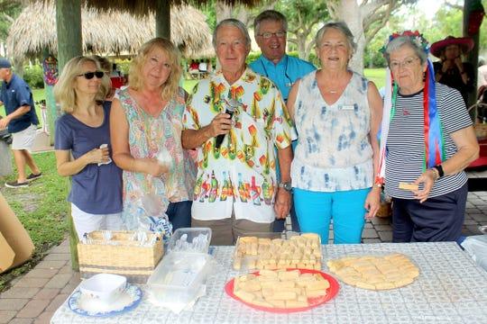 Enjoying the sopapillas baked by Dottie Daniels are Pat Arcidiacono, Bobbie Ordejia, Dave Walsh, Keith Wohltman, Dottie Daniels and Barb Markel.