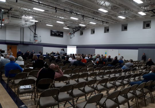 In a meeting that lasted more than five hours, more than 50 people addressed the Wauwatosa School Board on May 6 in the Fisher Building gym about the district's proposal to upgrade the athletic field at Wauwatosa East High School, replacing the natural grass surface with artificial turf and adding lights.