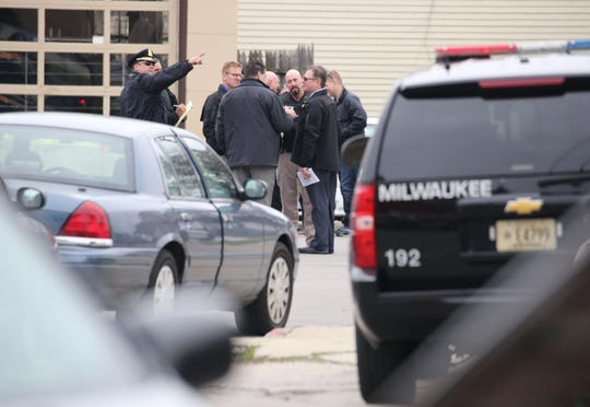 Investigators respond to the scene of an officer-involved shooting in which one of two people who approached plainclothes officers in what is believed to be a robbery attempt was shot and killed.