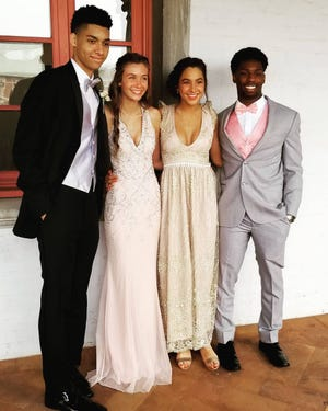 In 2019, Brookfield Central High School students, from left, Malik Abdul-Wahid, Isabella Orgeman, Paris Konzal and Rashad Lampkin took photos at the Villa Terrace before their prom at the Hilton Milwaukee City Center. This year, with COVID-19 still present, students at Brookfield Central and East high schools will need a negative coronavirus test to attend the event.