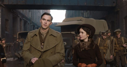 "Nicholas Hoult plays ""Lord of the Rings"" author J.R.R. Tolkien and Lily Collins is Edith, his future wife, in ""Tolkien."""