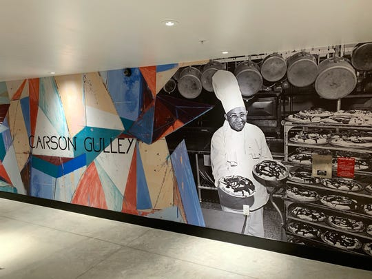 A mural in Hotel Indigo shows longtime UW-Madison chef Carson Gulley at work.  Gulley also led the NAACP's Madison branch for years.