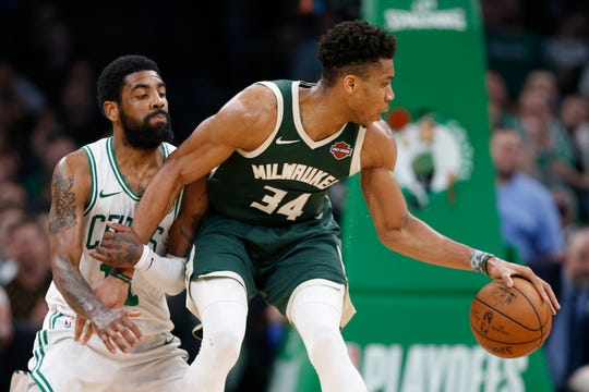 Bucks forward Giannis Antetokounmpo works against Celtics guard Kyrie Irving during the first half of Game 4.