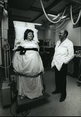 In this 1989 photo, Dr. Masood Akhtar tests Carol Gilbert on a tilt table at Sinai Samaritan Medical Center. Akhtar pioneered the specialty of electrophysiology in Wisconsin.