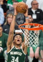 Bucks forward Giannis Antetokounmpo slam the ball during the third quarter Monday night.