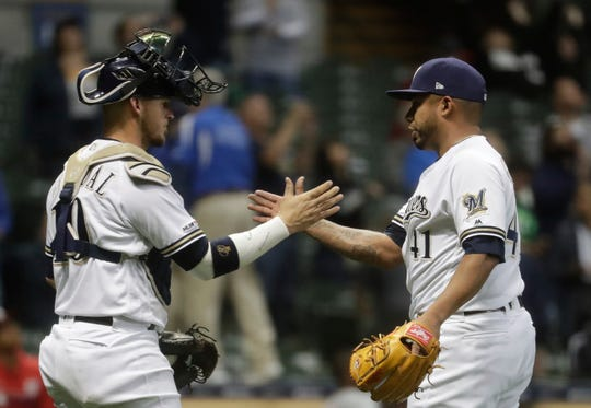 Brewers reliever Junior Guerra is congratulated by catcher Yasmani Grandal after setting the Nationals down in order with a pair of strikeouts to close the game Monday night at Miller Park.