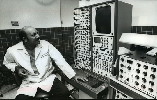 Masood Akhtar checks monitoring equipment during a test. He is professor of medicine at the University of Wisconsin Medical School.