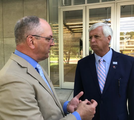 Gov. John Bel Edwards speaks to Ruston Mayor Ronny Walker at Northern Exposure Tuesday, May 7, about Ruston's recovery from a deadly tornado.