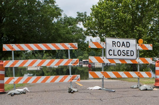 A road leading closer to the Ouachita River is closed in Forsythe Recreation Area due to the rising river waters on May 7 in Monroe, La. The river is at 45 ft. and could crest the levees if more rainfall occurs.