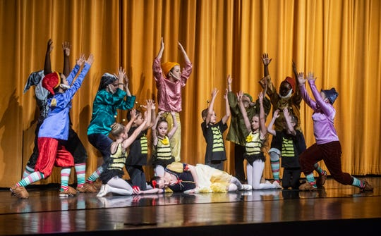 """The bees and the dwarfs stand over the poisoned Show White (Brandy Carwile). Montgomery Ballet performed """"Snow White"""" at Greenville High School on Sunday, May 5, 2019."""