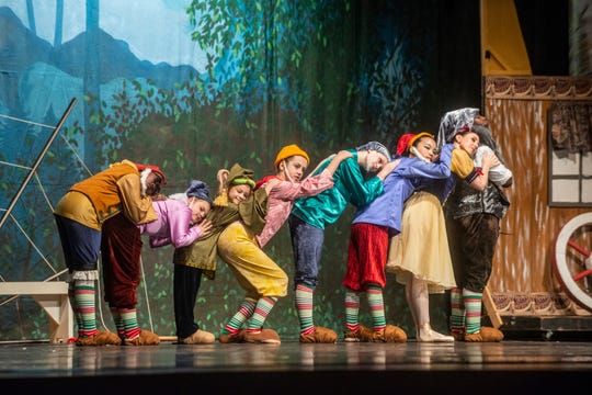 """Snow White (Brandy Carwile) and the Seven Dwarfs take a nap. Montgomery Ballet performed """"Snow White"""" at Greenville High School on Sunday, May 5, 2019."""