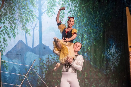 """The Prince (Thaddeus Morris) dances with the revived Snow White (Brandy Carwile). Montgomery Ballet performed """"Snow White"""" at Greenville High School on Sunday, May 5, 2019."""