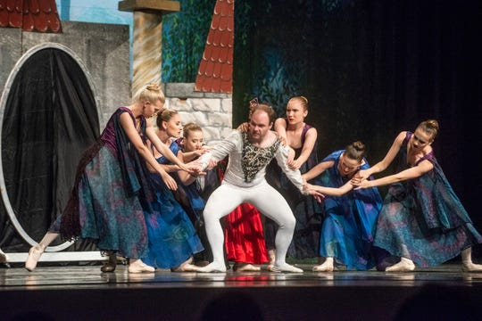 """The Prince (Thaddeus Morris) is pulled around by the Evil Queen and her court. Montgomery Ballet performed """"Snow White"""" at Greenville High School on Sunday, May 5, 2019."""