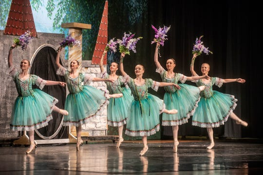 """Snow White's court (Rebecca Dugal, Dawn Kamphaus, Amber Malmstadt, Micaela Morris, Emily Simpson and Brenna Sumner) dance at the castle. Montgomery Ballet performed """"Snow White"""" at Greenville High School on Sunday, May 5, 2019."""