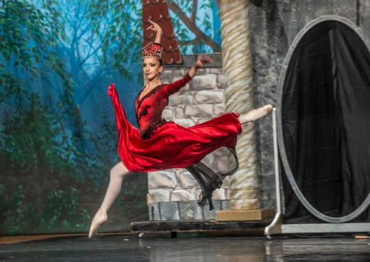 """The Evil Queen (Rania Charalambidou) dances at the castle. Montgomery Ballet performed """"Snow White"""" at Greenville High School on Sunday, May 5, 2019."""