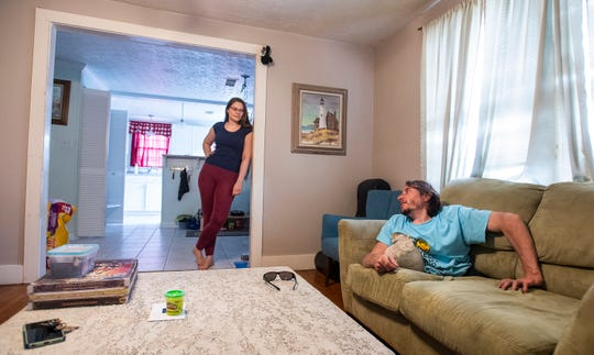 Rowdy Burton talks with his girlfriend Ilona Ruhl at their house in Montgomery, Ala., on Saturday May 4, 2019. Burton's legs were amputated when he was young because he has Sacral Agenesis.