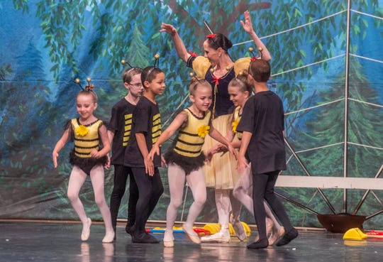"""Snow White (Brandy Carwile) is surrounded by little bees (Jules Morgan, Pearson Maguire, Evie McQuade, Kenna Perry, Collin Pridgen and Luchian Pridgen).Montgomery Ballet performed """"Snow White"""" at Greenville High School on Sunday, May 5, 2019."""