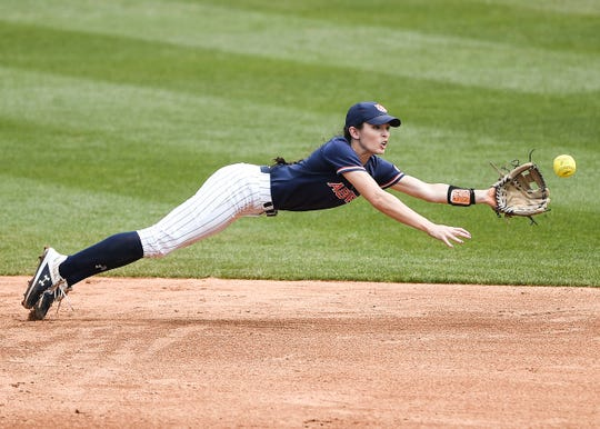 Auburn softball player Casey McCrackin dives to make a play.