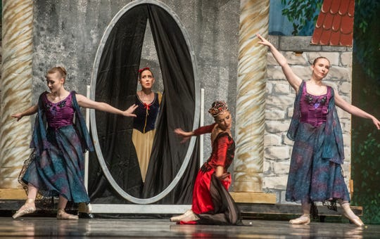 """Who is the fairest one of all? The Evil Queen (Rania Charalambidou) and her court see Snow White (Brandy Carwile) in the magic mirror. Montgomery Ballet performed """"Snow White"""" at Greenville High School on Sunday, May 5, 2019."""