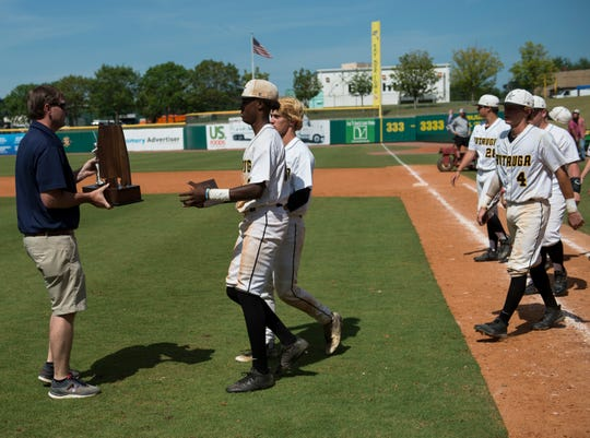 Autauga players accept the runner-up trophy during the AISA Class AA state championship at Riverwalk Stadium in Montgomery, Ala., on Tuesday, May 7, 2019. Lakeside defeated Autauga in both games of a doubleheader to win the championship.