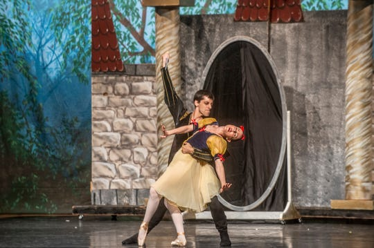 """The Hunter (Danny Mitsios) stand above Snow White (Brandy Carwile) with a knife. Montgomery Ballet performed """"Snow White"""" at Greenville High School on Sunday, May 5, 2019."""
