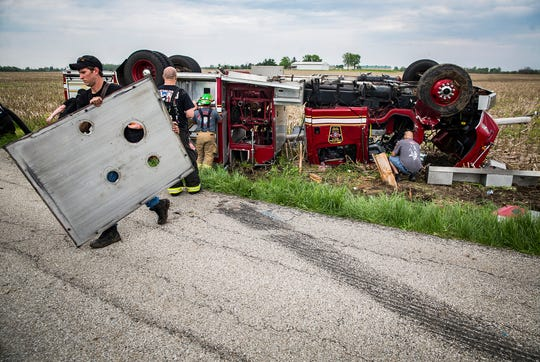 State and county police as well as other firefighters respond at the scene of a rollover wreck involving a Salem Township firetruck back in May.