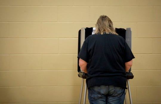 A Muncie resident casts their ballot on May 7 at Precinct 9 at the Southside Middle School. Voter turnouts both before the election and Tuesday afternoon were low according to officials.