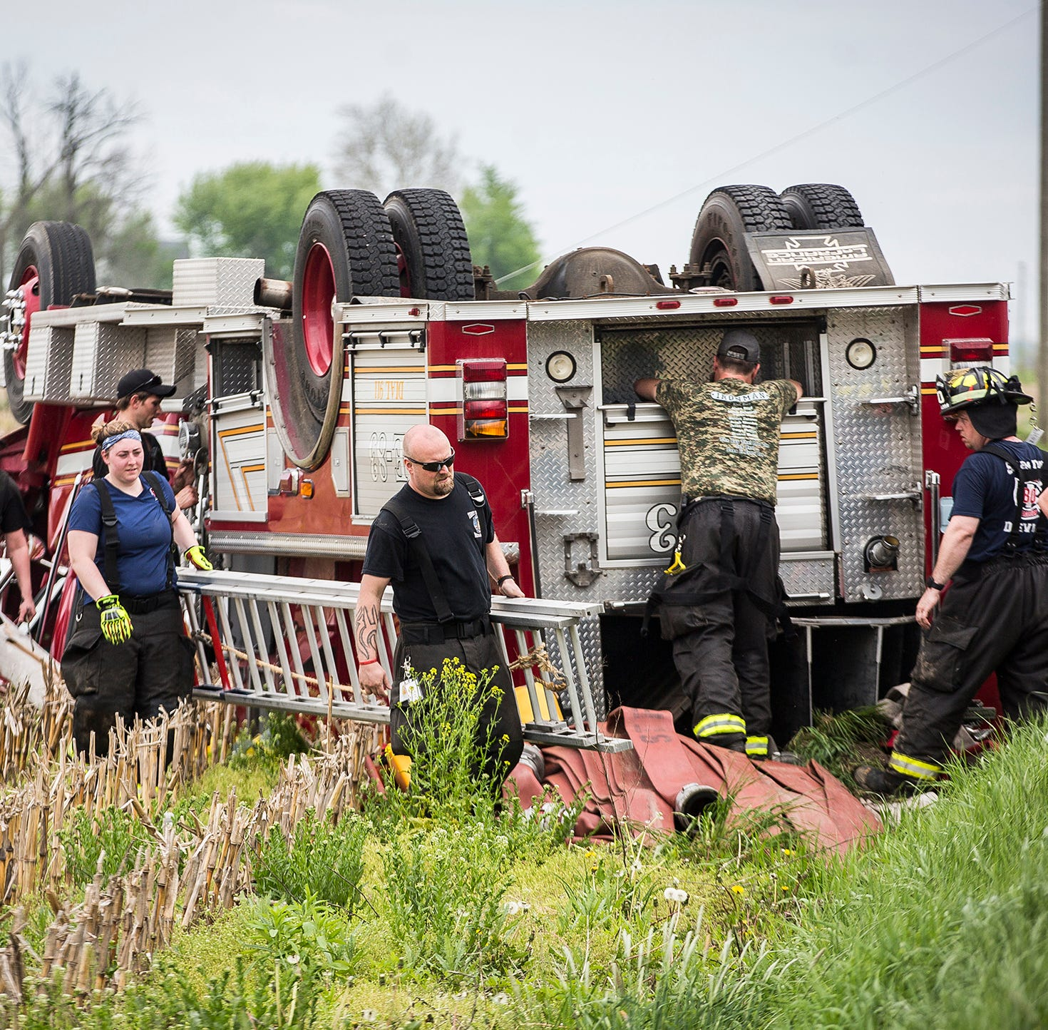 Electrical wires trap firefighters in firetruck rollover