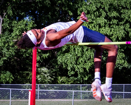Blackman's Emilio Martin clears 6-foot-6 in the high jump to win the event.
