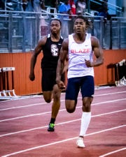 Blackman's Micaleous Elder (front) is shown during the subsectional track meet earlier this year. Elder is the all-area boys track and field athlete of the year.