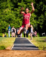 Riverdale's N'Dia Metcalf competes in the long jump.